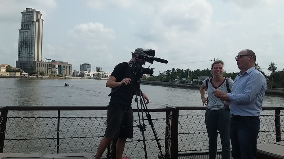 filming on a boat on Can Tho river