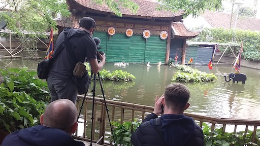 Filming water puppet show Hanoi